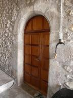 Pignon sud, porte occidentale.